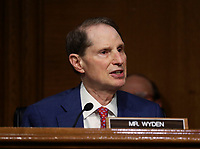 United States Senator Ron Wyden (Democrat of Oregon), Ranking Member, US Senate Committee on Finance, speaks during a hearing on the role of unemployment insurance during the coronavirus disease (COVID-19) pandemic on Capitol Hill in Washington, U.S., June 9, 2020.<br /> Credit: Leah Millis / Pool via CNP/AdMedia