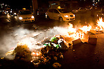 Ultra-Orthodox Jews, most of whom are young children, set garbage cans on fire and block the streets, while they continue to protest against the opening of a parking lot on the Shabbat day of rest, Jerusalem, Tuesday, June 30, 2009. Last Saturday marked the second Sabbath which brought thousands of Ultra-Orthodox Jews into the streets of Jerusalem in violent demonstration. Since Saturday the evenings in the Ultra-Orthodox neighborhoods have been marked with burning garbage cans and general unrest. Photo By: Olivier Fitoussi / JINI