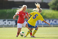 Amalie Vevie Eikeland of Norway battles with Elin Bragnum of Sweden during the UEFA Womens U19 Championships at Stebonheath park Sunday 25th August 2013. All images are the copyright of Jeff Thomas Photography-www.jaypics.photoshelter.com-07837 386244-Any use of images must be authorised by the copyright owner.