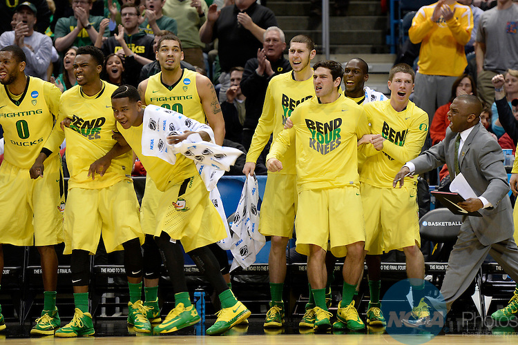 20 MAR 2014:  The University of Oregon bench celebrates against Brigham Young University during the second round of the 2014 NCAA Men's Basketball Tournament held at the BMO Harris Bradley Center in Milwaukee, WI.  Oregon defeated BYU 87-68.  Jamie Schwaberow/NCAA Photos