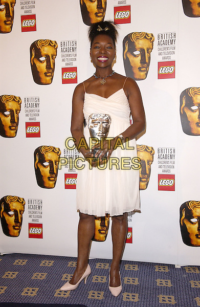 FOELLA BENJAMIN.British Academy Children's Film & Television Awards in Association With The Lego Company, Hilton Hotel, London..November 28th, 2004.Baftas, full length, white dress, award, trophy.www.capitalpictures.com.sales@capitalpictures.com.© Capital Pictures.