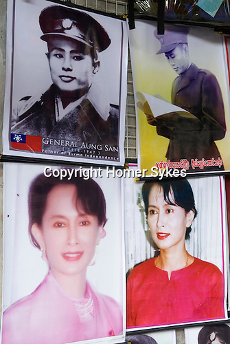 Aung San Suu Kyi and her father Aung San posters hanging up in street vendors stall. Rangoon Tangon Burma Myanmar 2011. Aung San  is considered the father of modern day Burma.