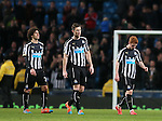Dejected players Fabrizo Coloccini, Michael Williamson and Jack Colback of Newcastle United - Barclays Premier League - Manchester City vs Newcastle Utd - Etihad Stadium - Manchester - England - 21st February 2015 - Picture Simon Bellis/Sportimage