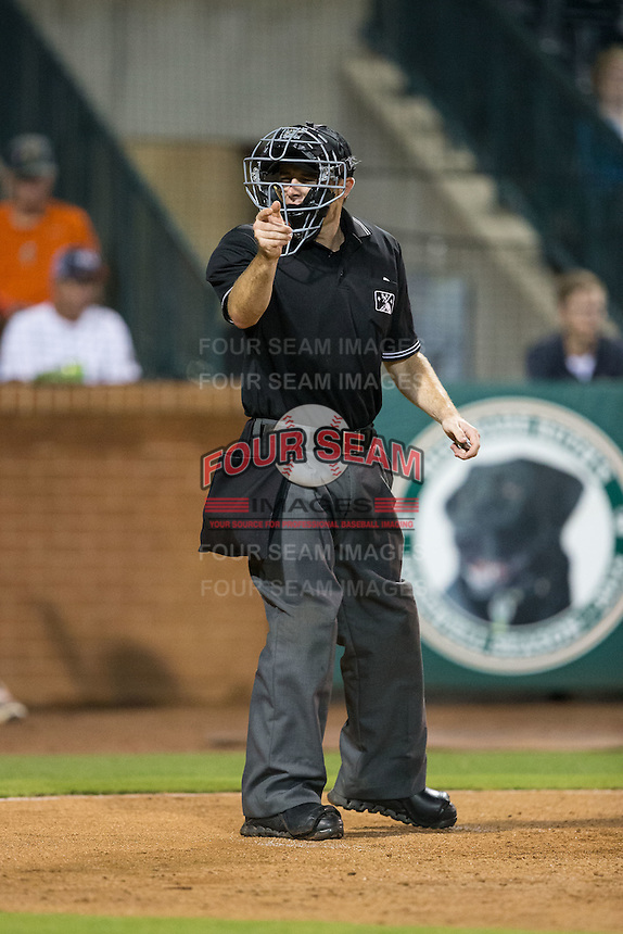 Home plate umpire Tom West makes a strike call during the South Atlantic League game between the Kannapolis Intimidators and the Greensboro Grasshoppers at NewBridge Bank Park on July 7, 2016 in Greensboro, North Carolina.  The Dash defeated the Pelicans 13-9.  (Brian Westerholt/Four Seam Images)