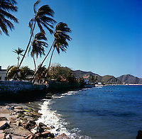Colombian homes and gardens backing onto the ocean, Santa Marta, Colombia. circa 1976