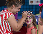 Three year old Rose gets her face painted during the  Greek Festival held at the St. Anthony's Greek Orthodox Church in Reno, Nevada on Friday, August 18, 2017.