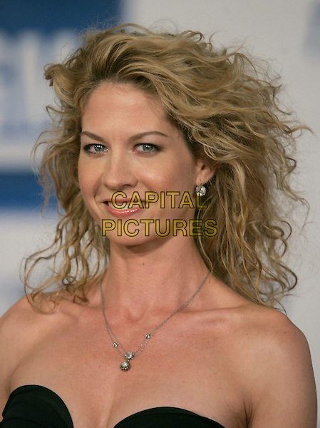JENNA ELFMAN.Attends The 5th Annual GM Ten Fashion Show held on Vine St. in Hollywood, California, USA - Arrivals..February 28th, 2006.Ref: DVS.headshot portrait strapless .www.capitalpictures.com.sales@capitalpictures.com.Supplied By Capital PIctures