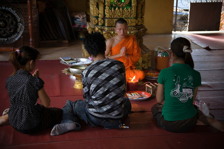 Daily worship of Buddhist people at Vat Simuang temple in Vientiane,Laos
