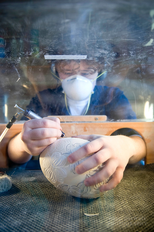 Rebekah Brown at work on an ostrich egg in her studio.