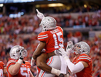 Ohio State Buckeyes running back Ezekiel Elliott (15) celebrates his touchdown in the second quarter of the Big Ten Championship game at Lucas Oil Stadium in Indianapolis on Saturday, December 6, 2014. (Columbus Dispatch photo by Jonathan Quilter)