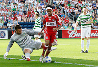 Chicago Fire forward Calen Carr (3) tries to dribble past Celtic FC goalkeeper Artur Boruc (1).  The Fire tied Celtic FC 1-1 at Toyota Park in Bridgeview, IL on July 22, 2007.