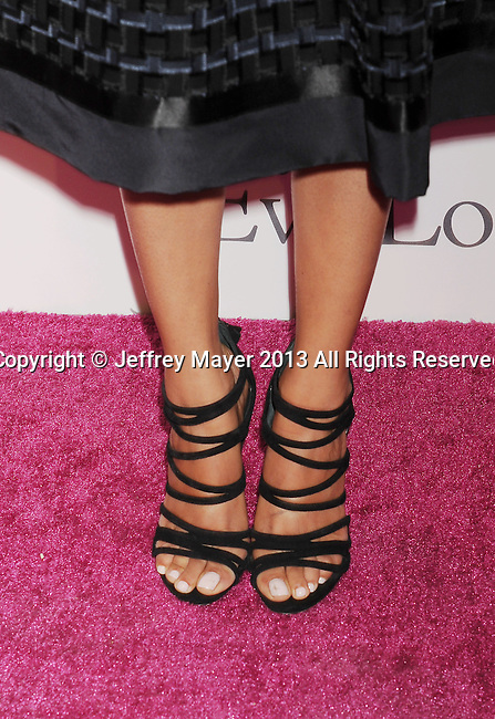 HOLLYWOOD, CA- SEPTEMBER 28: Actress Melonie Diaz (shoe detail) at the Eva Longoria Foundation Dinner at Beso restaurant on September 28, 2013 in Hollywood, California.