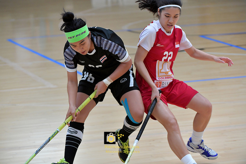Thailand's Kanya Jantapet and Singapore's Amanda Yeap in action during the World Floorball Championships 2017 Qualification for Asia Oceania Region - Singapore v Thailand at ASB Sports Centre , Wellington, New Zealand on Sunday 5 February 2017.<br /> Photo by Masanori Udagawa<br /> www.photowellington.photoshelter.com.