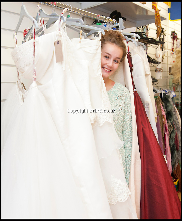 BNPS.co.uk (01202) 558833<br /> Picture: LauraJones/BNPS<br /> <br /> Amelia Platt from Charminster eagerly looking through the wedding dresses.<br /> <br /> A charity shop is being besieged by bargain-hunting brides after a mystery donor gave them 100 new wedding dresses.<br /> <br /> Staff at the PDSA store in Boscombe, Bournemouth, Dorset, were shocked when they opened several cardboard boxes left for them to find the pristine wedding and bridesmaid gowns inside.<br /> <br /> The garments have a combined retail price of more than £50,000 but the charity shop is selling them for huge discounted prices. One gown worth £1,500 is for sale for £250.