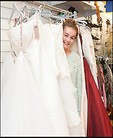 BNPS.co.uk (01202) 558833<br /> Picture: LauraJones/BNPS<br /> <br /> Amelia Platt from Charminster eagerly looking through the wedding dresses.<br /> <br /> A charity shop is being besieged by bargain-hunting brides after a mystery donor gave them 100 new wedding dresses.<br /> <br /> Staff at the PDSA store in Boscombe, Bournemouth, Dorset, were shocked when they opened several cardboard boxes left for them to find the pristine wedding and bridesmaid gowns inside.<br /> <br /> The garments have a combined retail price of more than &pound;50,000 but the charity shop is selling them for huge discounted prices. One gown worth &pound;1,500 is for sale for &pound;250.