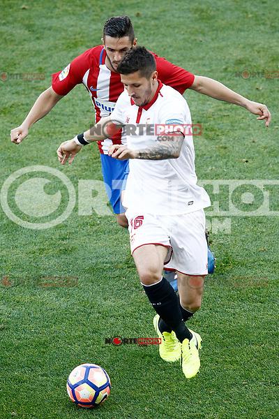Atletico de Madrid's Koke Resurrecccion (b) and Sevilla FC's Stevan Jovetic during La Liga match. March 19,2017. (ALTERPHOTOS/Acero) /NORTEPHOTO.COM