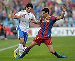 Real Zaragoza's Angel Lafita (l) and FC Barcelona's Sergio Busquets  during La Liga match.October 23,2010. (ALTERPHOTOS/Acero)