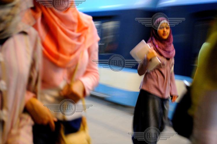 Women in a metro station.