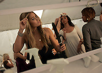 LOS ANGELES,CA - OCTOBER 14,2008: Lauren Conrad takes care of her own look before showing of The Lauren Conrad Collection at Spring 2009 shows at LA Fashion Week, October 14, 2008.