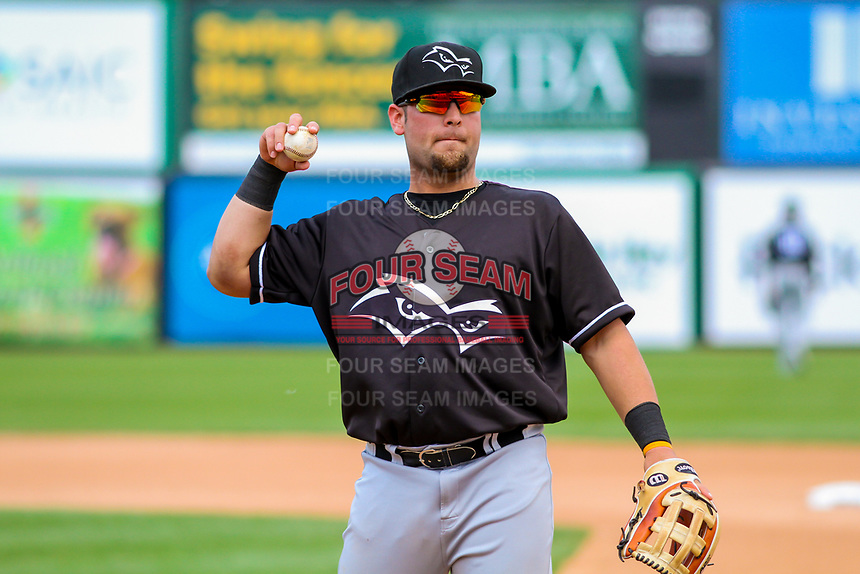 Quad Cities River Bandits first baseman Troy Sieber (21) prepares to toss a ball to the dugout between innings during a Midwest League game against the Wisconsin Timber Rattlers on June 27, 2017 at Fox Cities Stadium in Appleton, Wisconsin.  Quad Cities defeated Wisconsin 6-5. (Brad Krause/Four Seam Images)