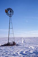 Windmill on Snowy Farm Field