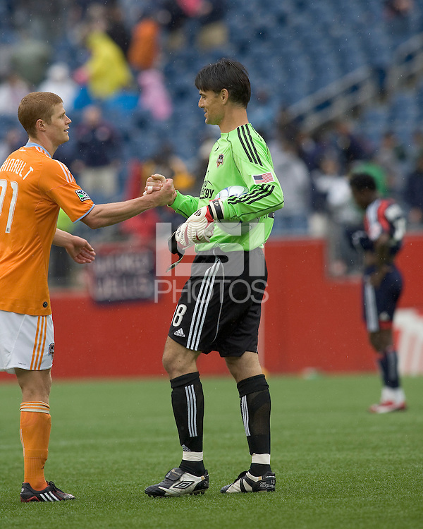 Houston Dynamo defender Andrew Hainault (31) congratulates Houston Dynamo goalkeeper Pat Onstad (18). The Houston Dynamo defeated the New England Revolution, 2-0, at Gillette Stadium on May 3, 2009.