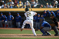 OAKLAND, CA - SEPTEMBER 18:  Mark Canha #20 of the Oakland Athletics bats against the Kansas City Royals during the game at the Oakland Coliseum on Wednesday, September 18, 2019 in Oakland, California. (Photo by Brad Mangin)