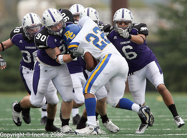 SIOUX FALLS - OCTOBER 11; Brandon Koolstra #90  and Andrew Schoenfelder #6 of the University of Sioux Falls along with a host of teammates bring down Stavhn Leavy #22 of Briar Cliff in the second quarter of their game Saturday afternoon at the USF complex in Sioux Falls. (photo by Dave  Eggen/Inertia)