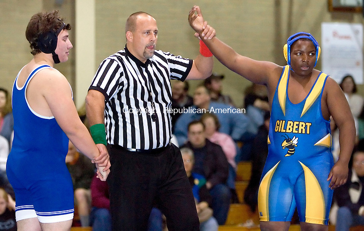 TORRINGTON, CT- 14 DECEMBER 2006-121406JS17-Gilbert's Jose DeJesu, right, is delared the winner after pinning Torrington's Kevin Neag in the 215 lb. class during  a meet Thursday at Oliver Wolcott Technical School in Torrington. <br /> Jim Shannon/Republican-American