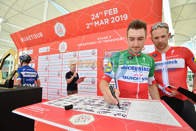 Italian National Champion Elia Viviani (ITA) Deceuninck-Quick Step and Danish National Champion Michael Mørkøv (DEN) sign on before the start of Stage 3 of the 2019 UAE Tour, running 179km form Al Ain to Jebel Hafeet, Abu Dhabi, United Arab Emirates. 26th February 2019.<br /> Picture: LaPresse/Massimo Paolone | Cyclefile<br /> <br /> <br /> All photos usage must carry mandatory copyright credit (© Cyclefile | LaPresse/Massimo Paolone)