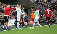 Pictured: Wayne Routledge of Swansea (R) is substituted by Ki Sung Yueng Sunday 30 August 2015<br /> Re: Premier League, Swansea v Manchester United at the Liberty Stadium, Swansea, UK