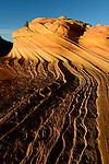 """Last light on the """"Second Wave"""" in the Coyote Buttes North special permit area of the Vermillion Cliffs wilderness area on the border with Utah and Arizona. This amazing, unique and fragile landscape is remote and heavily regulated"""