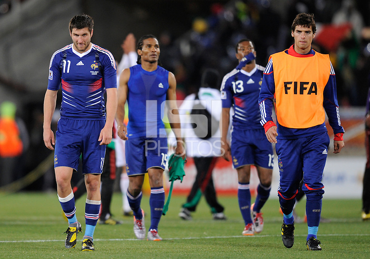 Andre Pierre Gignac of France (left) and team-mates look dejected after the defeat by Mexico