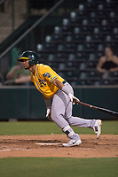 AZL Athletics third baseman Jordan Diaz (10) follows through on his swing during an Arizona League game against the AZL Angels at Tempe Diablo Stadium on June 26, 2018 in Tempe, Arizona. The AZL Athletics defeated the AZL Angels 7-1. (Zachary Lucy/Four Seam Images)