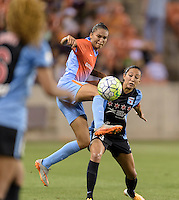 Houston Texas - Poliana (2) of the Houston Dash steps in front of Christen Press (23) of the Chicago Red Stars to take control of the ball in the first half Saturday, April 16, 2016 at BBVA Compass Stadium in Houston Texas.  The Houston Dash defeated the Chicago Red Stars 3-1.