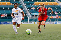 Rochester, NY - Friday June 17, 2016: Portland Thorns FC defender Emily Menges (4), Western New York Flash defender Taylor Smith (11) during a regular season National Women's Soccer League (NWSL) match between the Western New York Flash and the Portland Thorns FC at Rochester Rhinos Stadium.