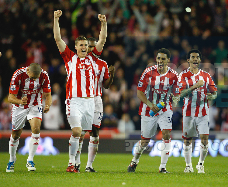 Stoke City's Robert Huth celebrates victory in the shoot out with Ryan Shotton,Jermaine Pennant and Jon walters