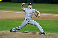 Pitcher Spencer Kulman (23) of the Wofford College Terriers delivers a pitch in a game against the Clemson University Tigers on Tuesday, March 1, 2016, at Doug Kingsmore Stadium in Clemson, South Carolina. Clemson won, 7-0. (Tom Priddy/Four Seam Images)
