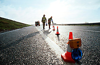 Firefighters laying cones to close off a motorway following a road traffic accident...© SHOUT. THIS PICTURE MUST ONLY BE USED TO ILLUSTRATE THE EMERGENCY SERVICES IN A POSITIVE MANNER. CONTACT JOHN CALLAN. Exact date unknown.john@shoutpictures.com.www.shoutpictures.com.