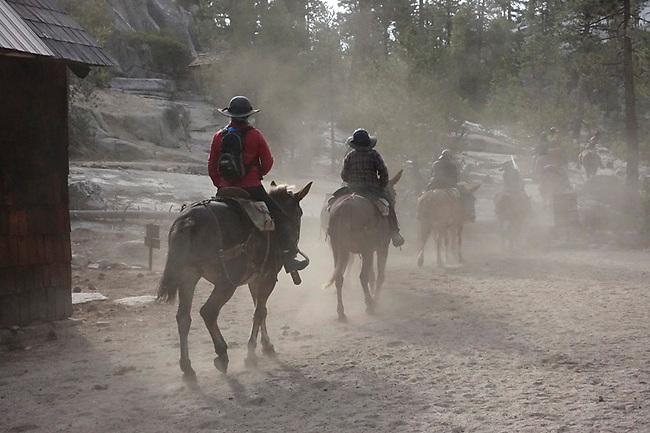 Riders leaver Merced Camp on High Sierra Camp ride