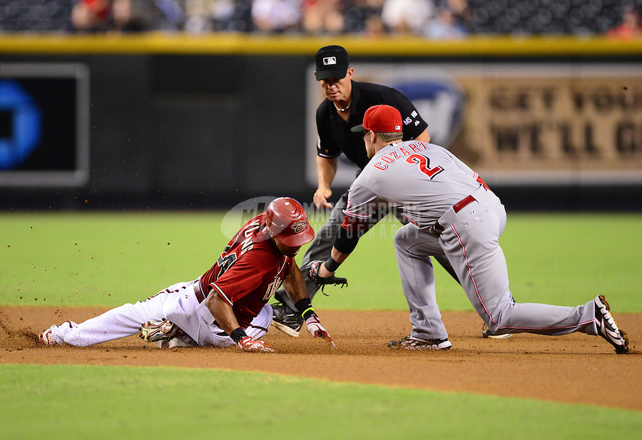 Aug. 29, 2012; Phoenix, AZ, USA: Arizona Diamondbacks base runner (24) Chris Young is tagged out at second base by Cincinnati Reds shortstop (2) Zack Cozart in the first inning at Chase Field. Mandatory Credit: Mark J. Rebilas-