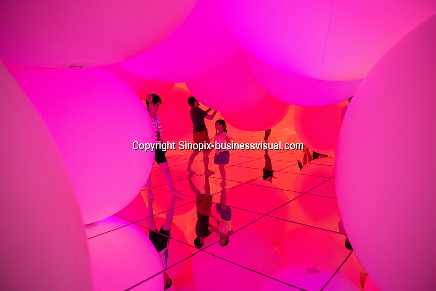 """Expanding Three-Dimensional Existence in Transforming Space"" is  a collection of large ballons that float and cjhange color creating an everchanging exhibit in Team Lab Planets, Tokyo, Japan, July-2019."
