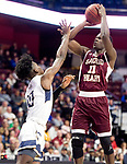 UNCASSVILLE, CT-031818JS09- Sacred Heart's Raheem Solomon puts up two of his game-high 33 points over Notre Dame-Fairfield's Wooley Monnexant (10) during their Division I championship game Sunday at Mohegan Sun Arena. <br /> Jim Shannon Republican-American