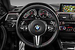 Car pictures of steering wheel view of a 2016 BMW M4 2 Door Coupe Steering Wheel
