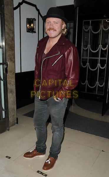 Leigh Francis aka Keith Lemon.The Very.co.uk s/s 2013 catwalk show, Claridge's Hotel, Brook St., London, England..September 13th, 2012.full length black hat maroon burgundy red leather jacket jeans denim hand in pockets moustache mustache facial hair brown loafers shoes .CAP/CAN.©Can Nguyen/Capital Pictures.