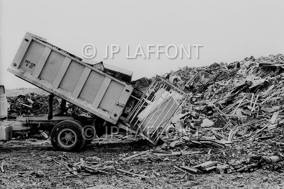 1967, New York City: The truck of sanitation department dumping city waste in a huge junk yard in the Bronx.