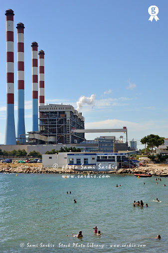 People bathing near a thermal Power Station, Lavera, Mediterranean coast, France<br />  (Licence this image exclusively with Getty: http://www.gettyimages.com/detail/85071247 )