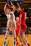 BROOKING, SD - NOVEMBER 13:  Clarissa Ober #21 from South Dakota State shoots a short jumper over Tori Jarosz #44 and Sydney Coffee #5 form Marist in the second half of their game Friday night at Frost Arena in Brookings. (Photo by Dave Eggen/Inertia)