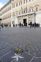 Roma 14 Ottobre 2011.Indignati.I giovani con il Drago in Piazza Montecitorio durante il voto di fiducia al Governo Berlusconi.Le uova lanciate sul selciato