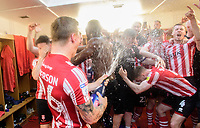 Lincoln City's Harry Anderson sprays champagne over his team-mates as they celebrate winning the league<br /> <br /> Photographer Chris Vaughan/CameraSport<br /> <br /> The EFL Sky Bet League Two - Lincoln City v Tranmere Rovers - Monday 22nd April 2019 - Sincil Bank - Lincoln<br /> <br /> World Copyright © 2019 CameraSport. All rights reserved. 43 Linden Ave. Countesthorpe. Leicester. England. LE8 5PG - Tel: +44 (0) 116 277 4147 - admin@camerasport.com - www.camerasport.com